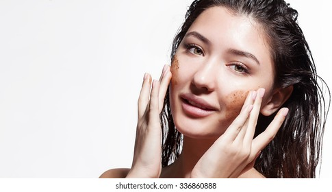 Young woman doing facial peels coffee scrub