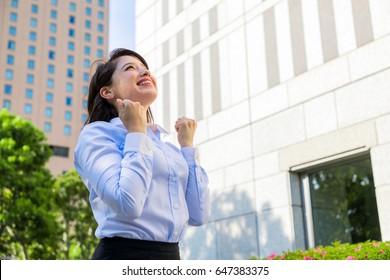 young woman doing fists pump. business motivation concept.