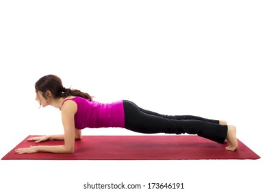Young woman doing forearm plank pose in yoga (Series with the same model available)