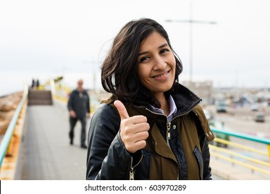 young woman doing gesture ok in the street
