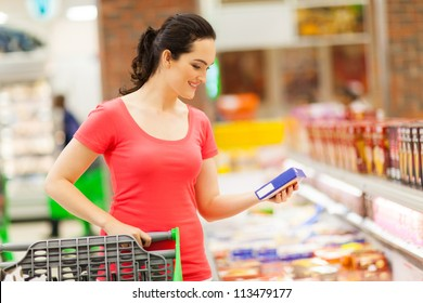 young woman doing grocery shopping in supermarket