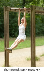 young woman doing physical exercise outdoors