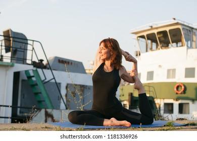 young woman doing pigeon yoga pose