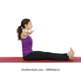 Young woman doing pilates abs exercises.
