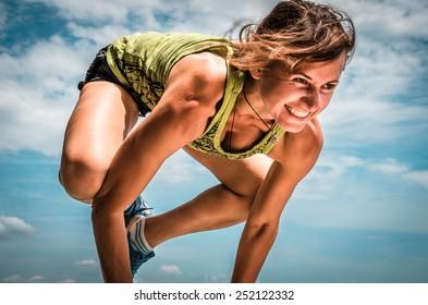 Young woman doing pose arm balance