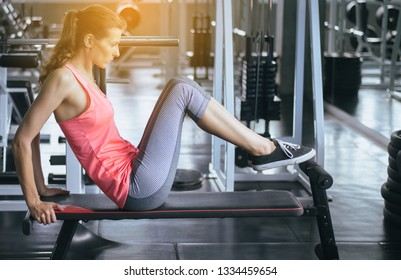 Young  woman doing situp or crunches in gym,Female exercise muscular her stomach