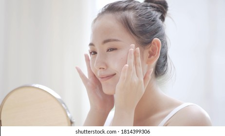 Young woman doing skin care - Shutterstock ID 1814399306