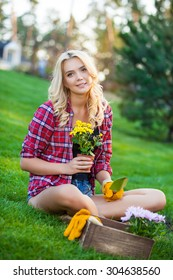 Young woman doing some gardening on a sunny day