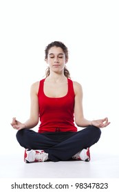Young woman doing some yoga after the exercise (isolated on white)