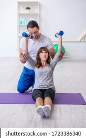 Young woman doing sport exercises with personal coach