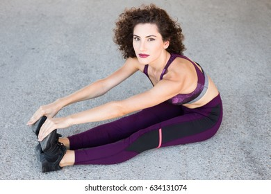 Young woman doing sport: stretching