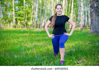 Young woman doing sports in the forest