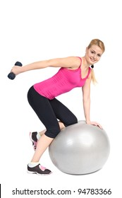 Young woman doing Standing Bent-Over Dumbbell Triceps Extension on Fitness Ball, phase 2 of 2.