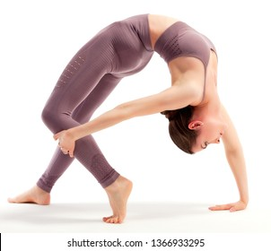 young woman doing yoga exercise over white background, isolated
