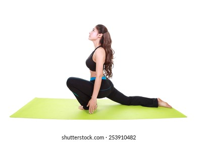 Young woman doing yoga exercise with yoga mat isolated on white background