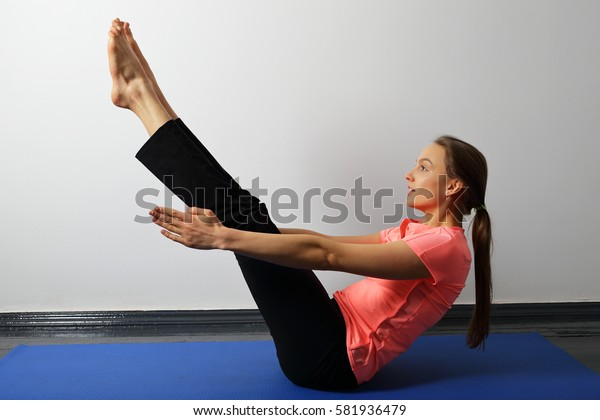 Young woman doing yoga exercise static for press and core