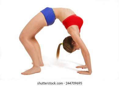 Young woman doing Yoga exercises on white background. Bridge pose - Urdhva Dhanurasana