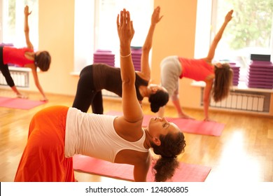 Young woman is doing yoga at health club