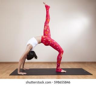 A young woman doing yoga meditation at studio