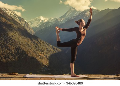 Young woman doing yoga in mountains outdoor. Morning Fitness, Yoga tours