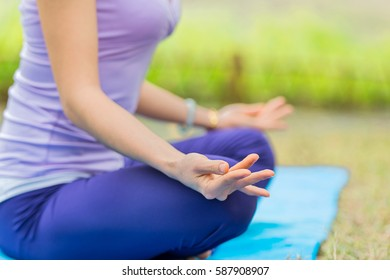 Young woman doing yoga in the park.