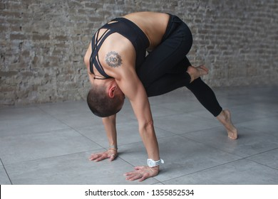 young woman doing yoga plank exercise in yoga studio minimalistic interior