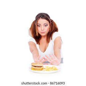 young woman don't want to eat junk food. isolated on white background
