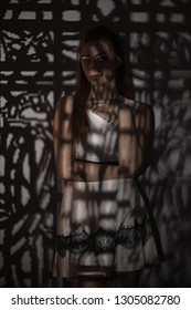 young woman in dress with light pattern concept beauty and and mystery, gobo masks