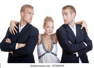 young woman in dress standing between two men in suits - isolated on white
