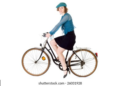 young woman dressed in french style riding bicycle