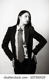 young woman dressed up in a man suit and tie
