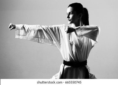 Young Woman Dressed In Traditional Kimono Practicing Her Karate Moves - Black Belt