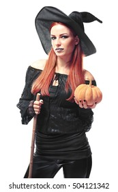 Young woman dressed in witch costume for Halloween, isolated on white