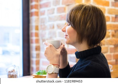 Young woman drinking coffee in the cafe