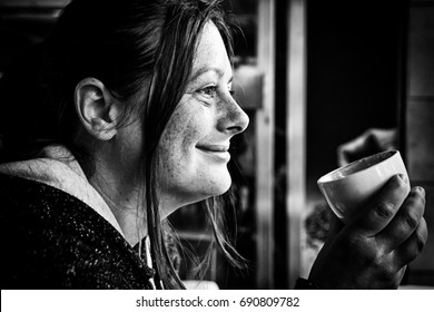 Young woman drinking coffee, detail of a cold winter day, hot drink