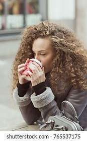 Young woman drinking coffee outdoor