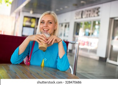 young woman drinking a frappe coffee