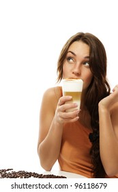 young woman drinking latte macchiato coffee looking up on white background