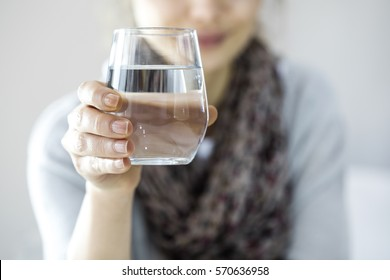 Young woman drinking water - Shutterstock ID 570636958