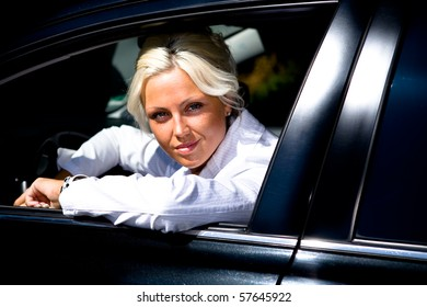 a young woman driving the car