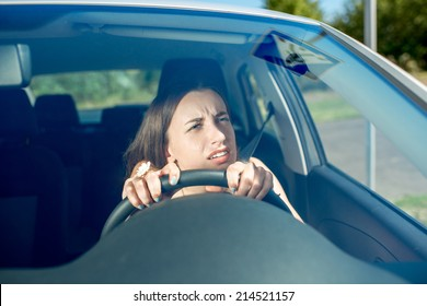 Young woman driving car. Windshield view
