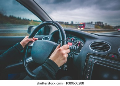 Young woman driving on motorway