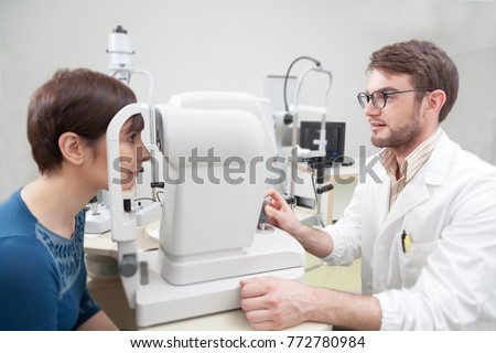 17f3692b4df Young woman during an eye exam with the ophthalmologist eye Doctor is  calculating a patient s vision