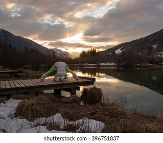 Young woman during her morning yoga routine. Excercise in nature at sunrise.