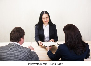 Young woman during job interview and members of managemen