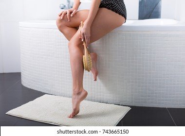 Young woman during morning routine in the bathroom