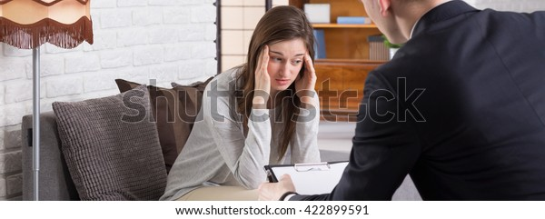 Young woman during psychotherapy, elegant psychologist back view, panorama