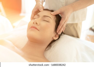 Young Woman during Spa Salon. Woman Relaxes in the spa. Spa Body massage woman Hands Treatment. woman having Thai massage in the spa salon.