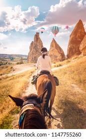 young woman during vacation in Turkey Kapadokya watching the hot air balloons of Cappadocia