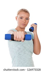 Young woman during workout with dumbbells, looking at camera